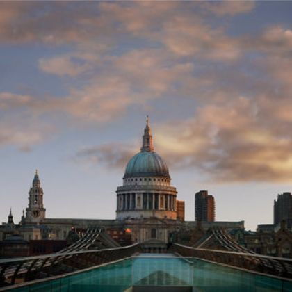 The Millennium footbridge over the River Thames in London looking towards St Paul's cathedral and the City of London.