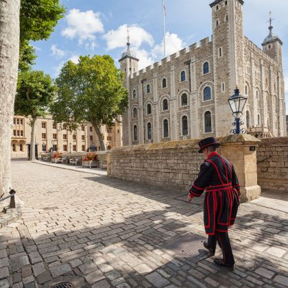 Beefeater walking by the, Tower of London, London, England.