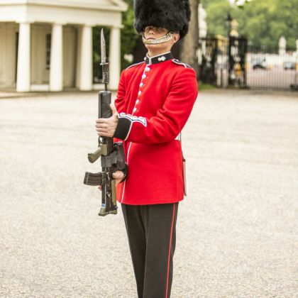 A Queen's Guard standing outside Buckingham Palace
