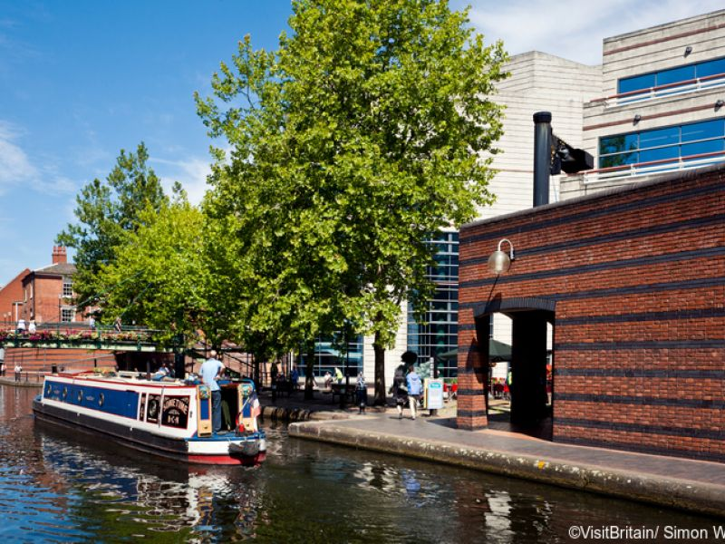 Gas Street Basin is on the historic Birmingham canal, which was completed in the late 18th century. The canal has traditional and tourist traffic and narrowboats carry people and goods through the city.