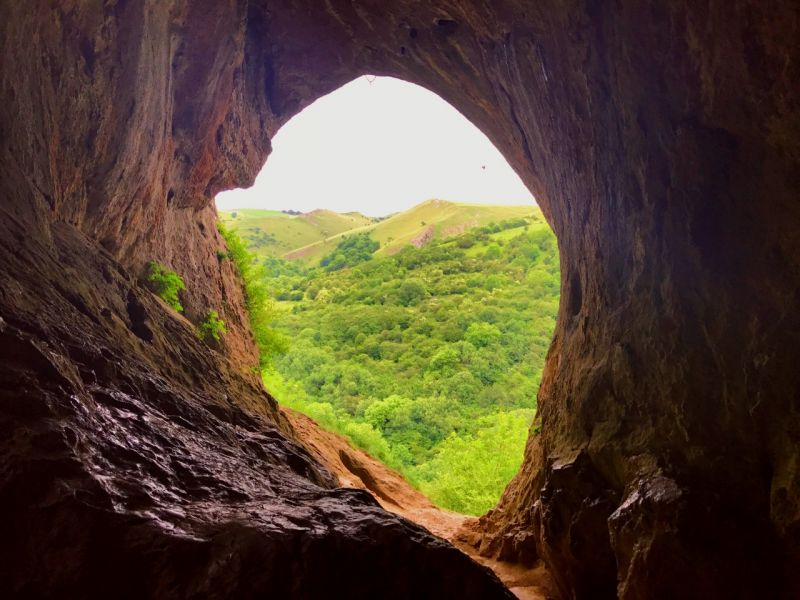 View from the inside Thors Cave looking onto the valleys of the Peak District Credit to Rebecca Read/VisitBritain