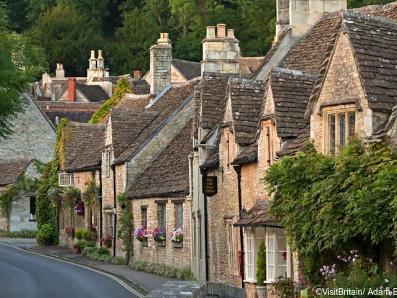 Traditional Cotswold stone houses in the village of Castle Combe on the village high street.