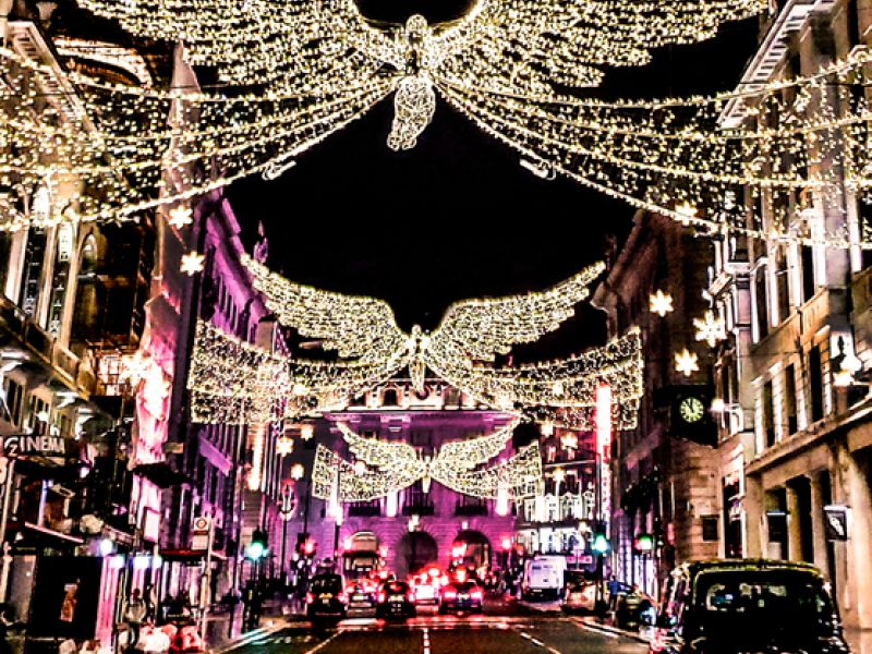 Christmas light display above traffic on Regent Street, London, England.