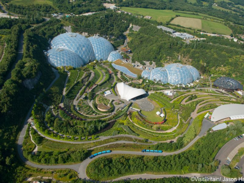 Aerial image of The Eden Project, a travel destination and ecological park, an educational visitor attraction in a series of dramatic biodomes. They have the world's largest rainforest in an enclosed space. Credit to VisitBritain/ Jason Hawkes