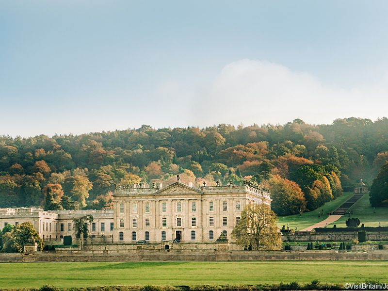 Front view of Chatsworth House with hills behind, Peak District, Derbyshire, England.