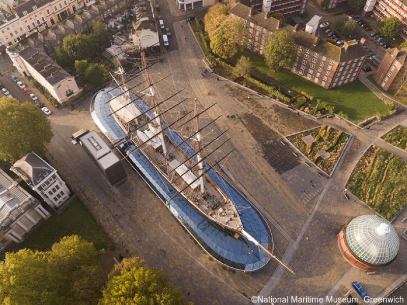 UAV drone photography early morning at Cutty Sark, Greenwich, London. Views over docklands & river Thames, deck views & rigging