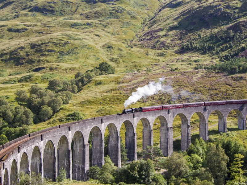 Jacobite steam train crossing Glenfinnan Viaduct, Inverness-shire, Scotland.