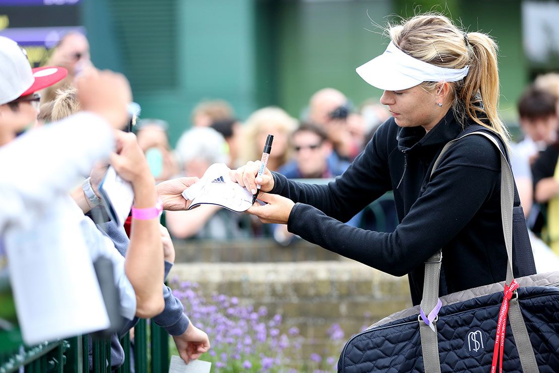 Players signing autographs for the fans at Wimbledon