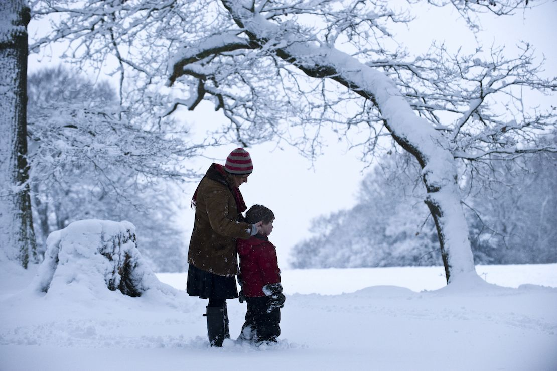Woman and child in the snow at Box Hill