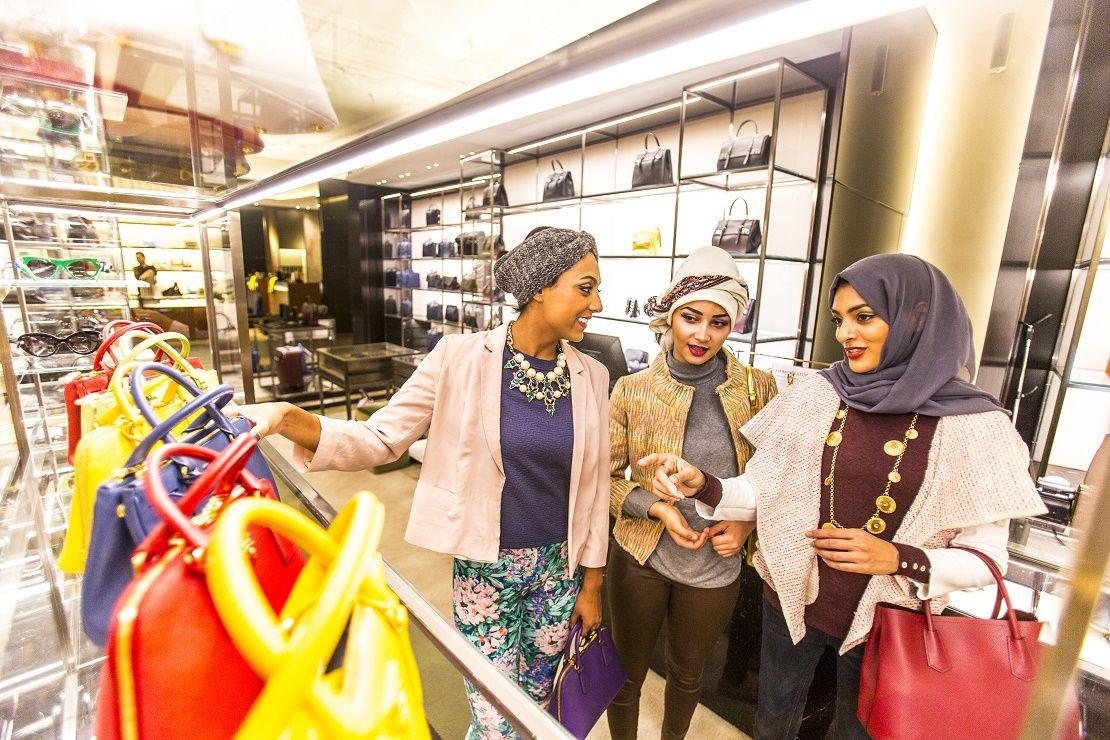 3 ladies shopping for handbags