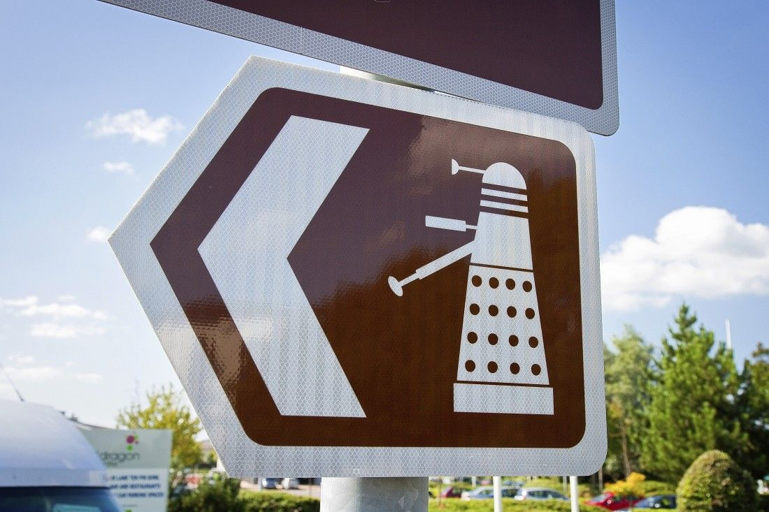 A road sign for the Doctor Who Experience in Cardiff, Wales.