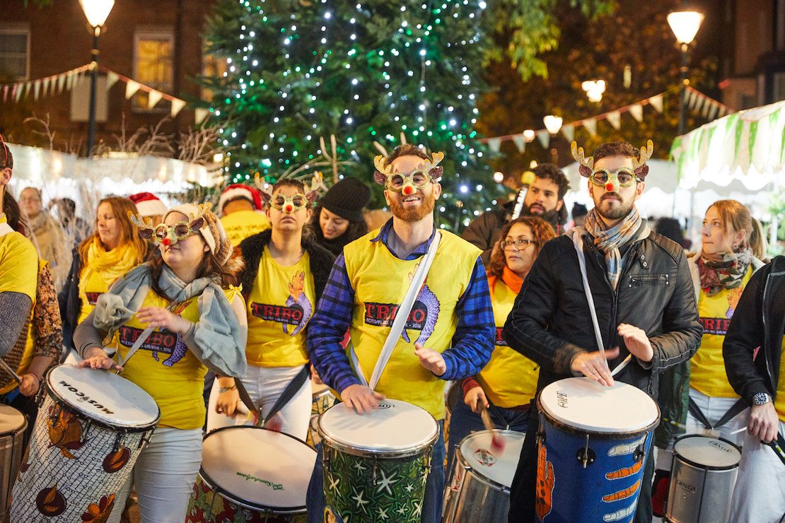 A samba band dressed in festive costumes.