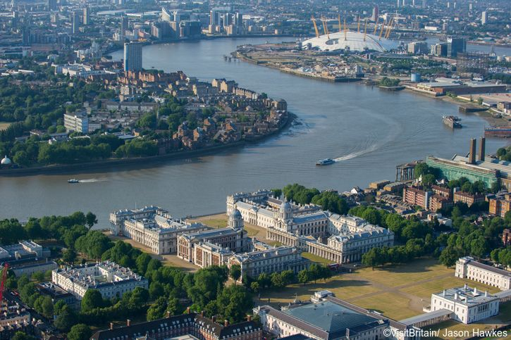 Aerial view over London, the River Thames and the historic buildings and parks of Greenwich. The Old Royal Naval College, maritime Greenwich, a UNESCO world heritage site and 18th century building
