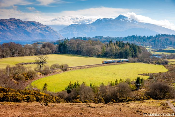 Train crossing the rural landscape of Argyll and Bute, Scotland.