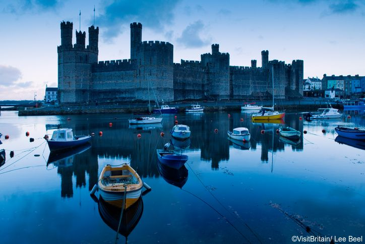 Caernarvon castle is a historic site dominating the town of Caernarvon, overlooking the Menai straits. Afon Seiont at dusk. Credit to VisitBritain/ Lee Beel
