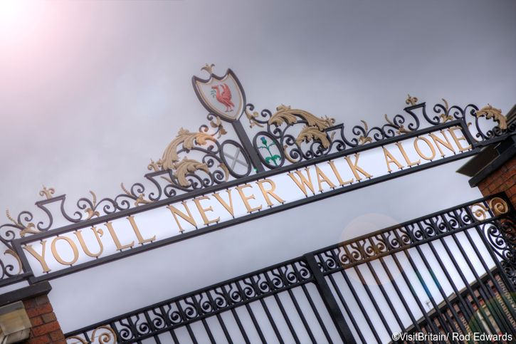 The words 'You'll Never Walk Alone' from the club's adopted anthem feature on the club crest and on the Shankly Gate entrance to Anfield stadium, the home stadium of Liverpool football club.