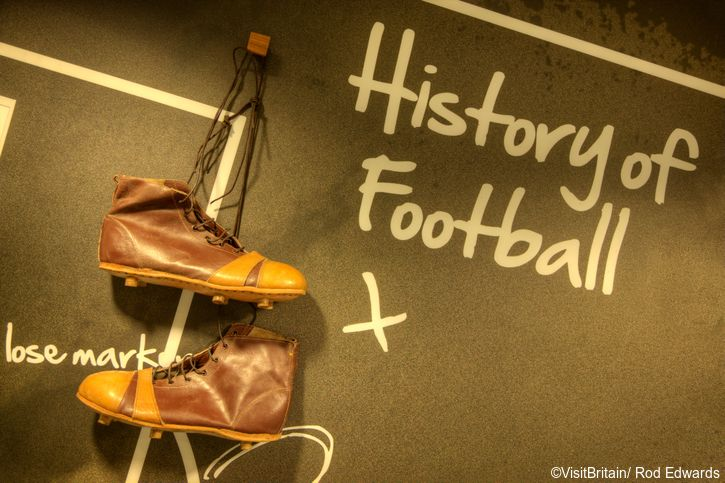 Old leather football boots on the wall at The Boot Room Sports Cafe at Anfield, home of Liverpool Football Club.