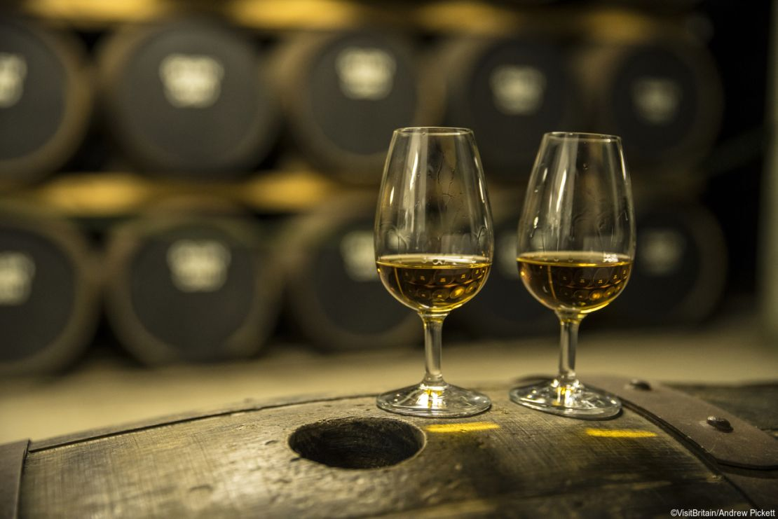 Two glasses of whisky on a cask during the Scottish Whisky Month.