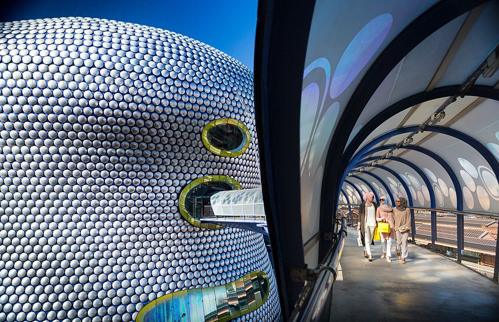 Bullring covered walkway to Selfridges Department store in Birmingham, England. Curved facade with aluminium disc cladding.