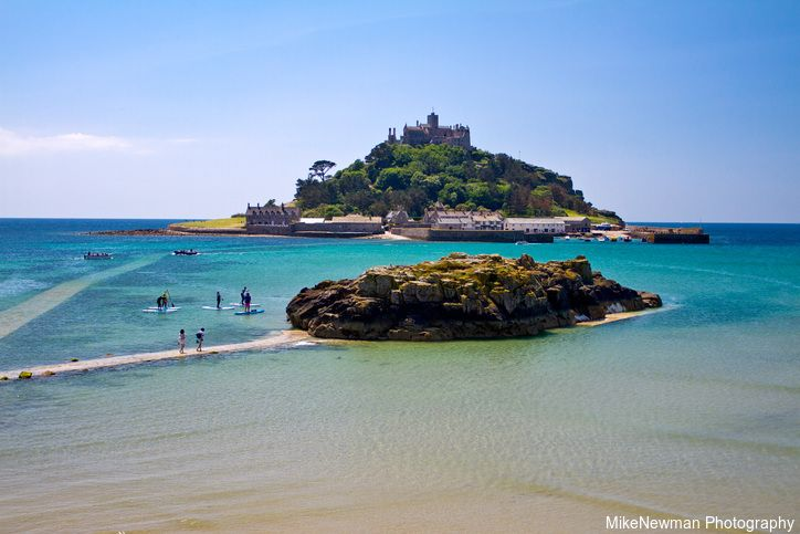 Summer view from Marazion on St Michael's Mount as the tide comes in, Cornwall, England