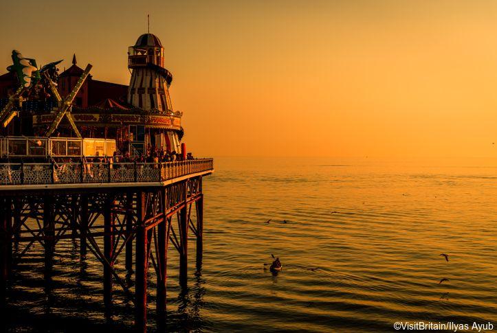 Brighton Pier in the evening sunset glow, Brighton, East Sussex, England. Credit to VisitBritain/Ilyas Ayub
