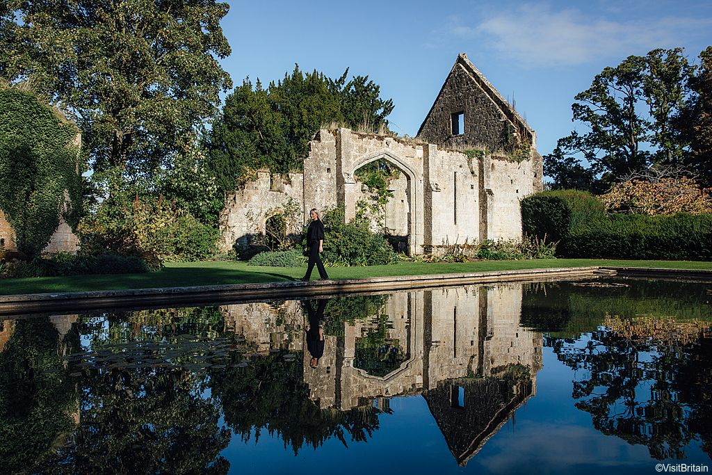 A woman walking in the gardens of Sudeley Castle & Gardens, Gloucestershire, England. Credit to VisitBritain