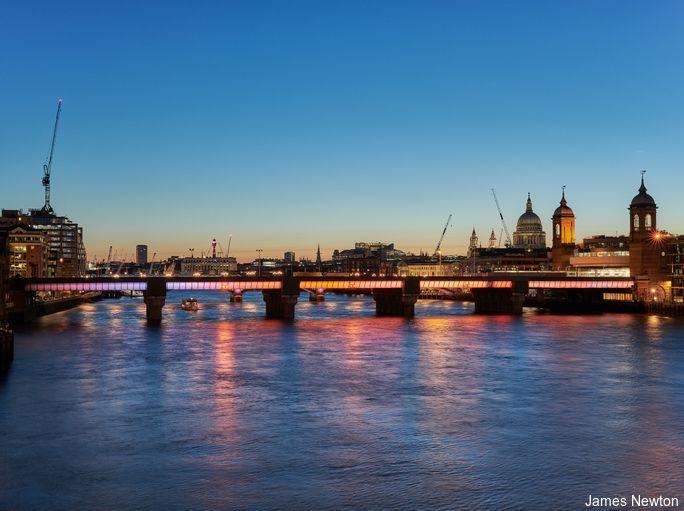 Iconic London bridge by Canon Street lit up by Illuminated Bridges, 2021 stories. Credit to James Newton