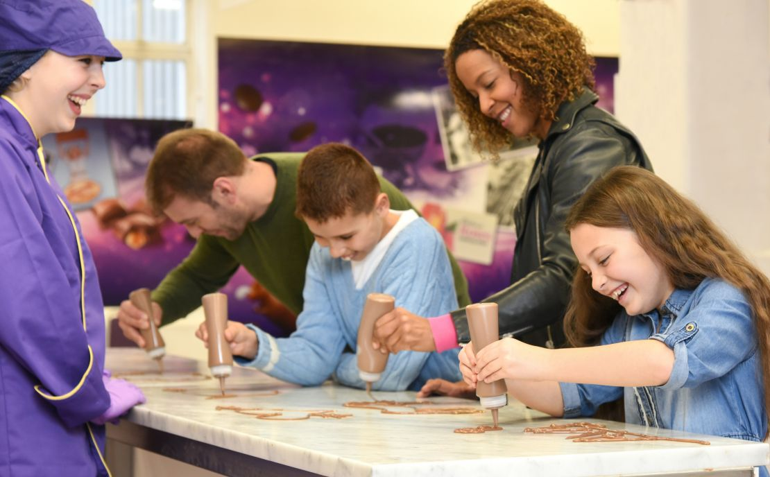Children perfect their chocolate writing skills in the Have A Go zone at Cadbury World, Birmingham.