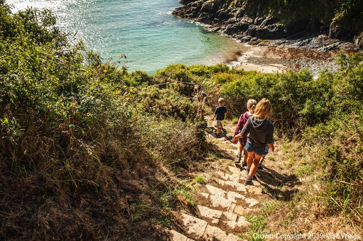 Hikers walking down Wales Coast Path