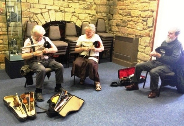 Playing Northumbrian pipes in Morpeth Bagpipe Museum - photo by Zoe Dawes