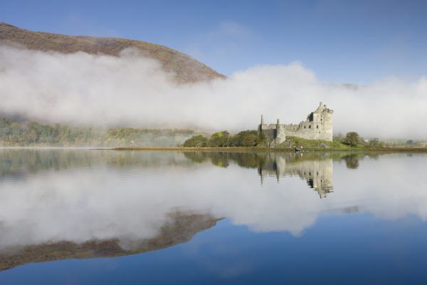 Morning mist surrounds the ruins of Kilchurn Castle on the shores of Loch Awe,