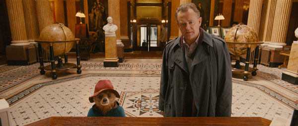 Scene from Paddington film of Hugh Bonneville and Paddington