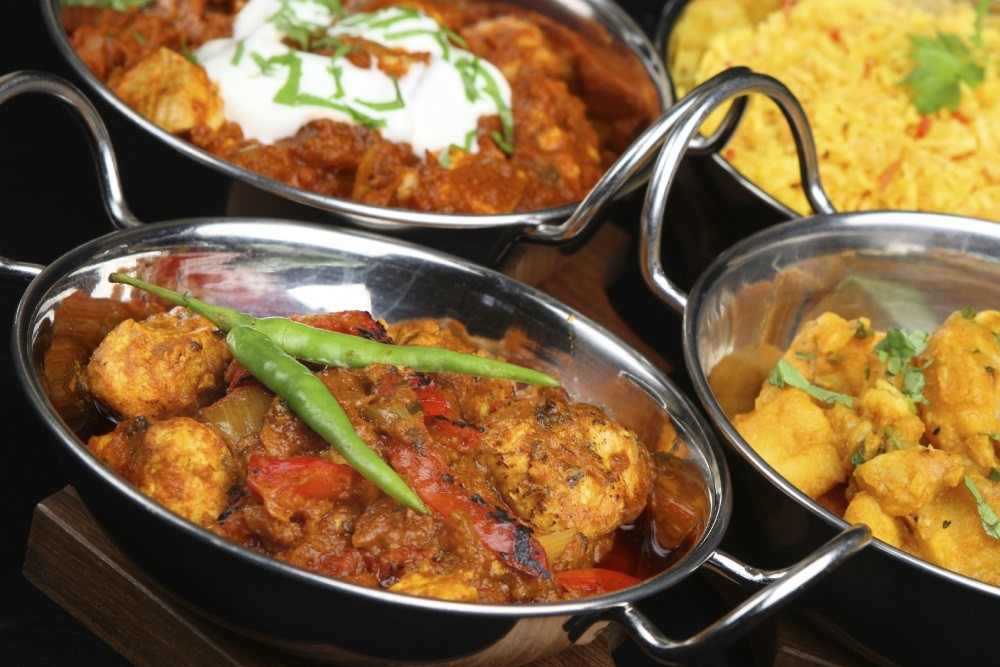 Selection of Indian curries in balti serving dishes