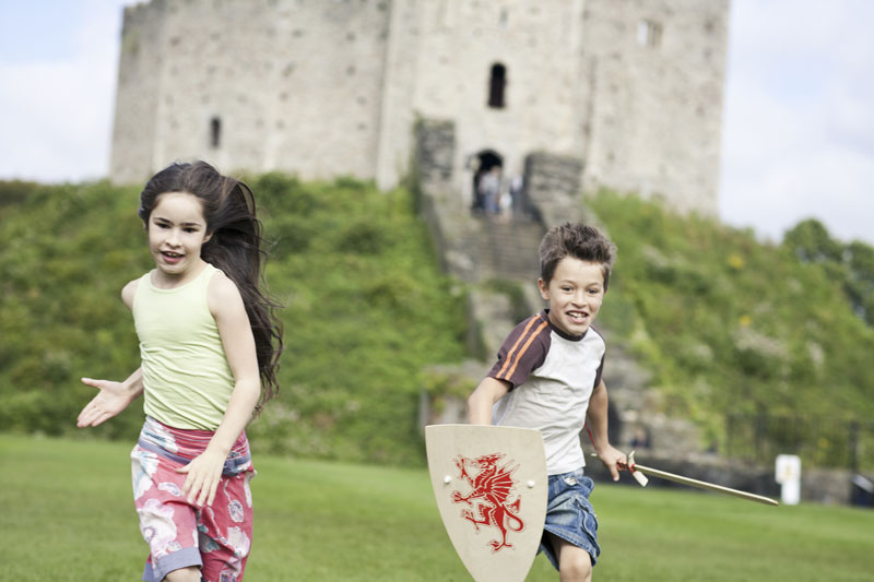 Children running in the grounds of Cardiff Castle