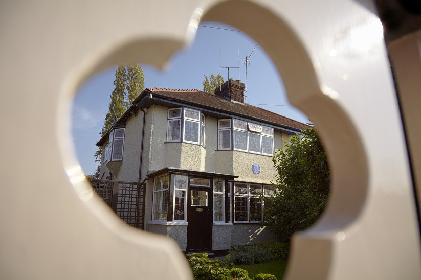 The exterior seen through the garden gate at Mendips, the childhood home of John Lennon, in Woolton, Liverpool.