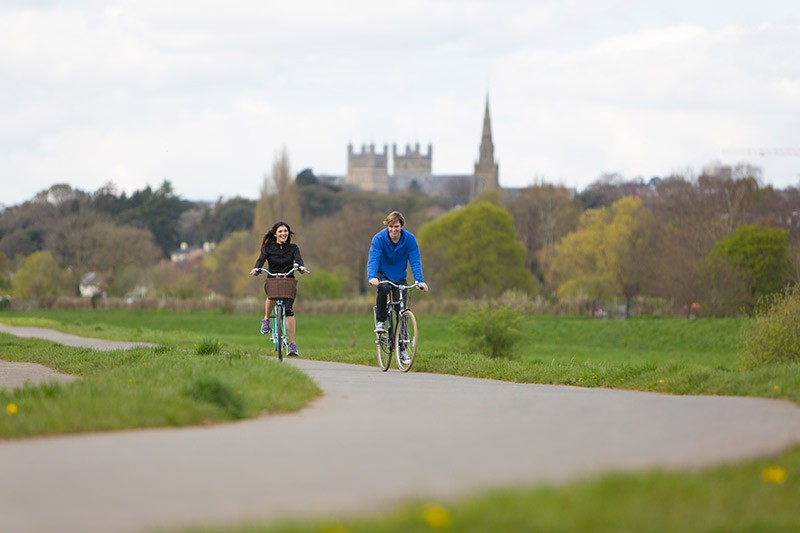 Cycling along the River Exe in Exeter, Devon