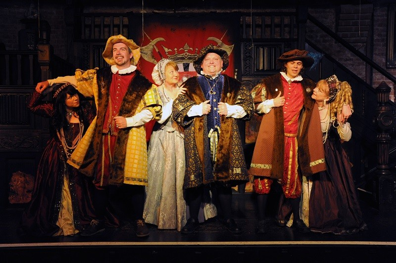 Medieval characters perform on stage at Coombe Abbey Hotel, Warwickshire.